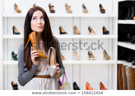 young woman choosing shoes at store stock photo © dolgachov
