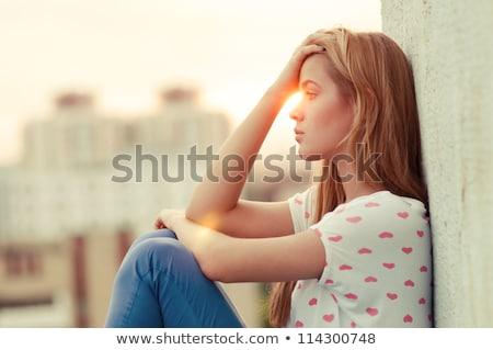 Blonde sad young woman Stock photo © Kzenon