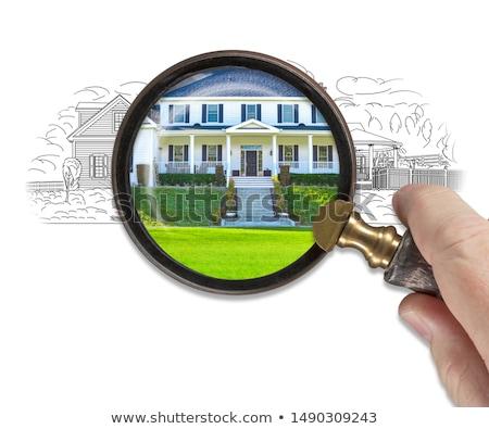 Hand vergrootglas afgewerkt huis bouwen Stockfoto © feverpitch