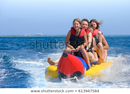 Water Fun People Riding Banana Boat in Summer Stock photo © robuart