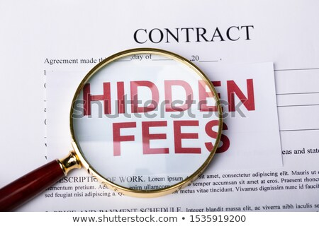 Magnifying Glass On Hidden Fees Stock photo © AndreyPopov