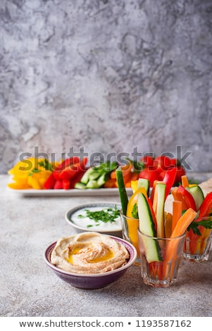 Snacks bar. Vegetables sticks and hummus Stock photo © furmanphoto