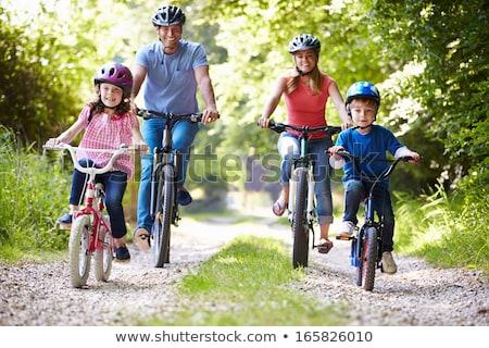 счастливая · семья · верховая · езда · велосипедах · улице · улыбаясь · отец - Сток-фото © galitskaya