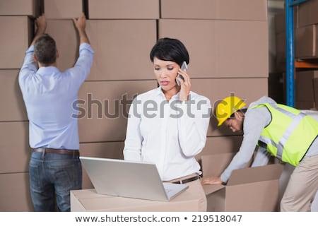 Frente vista mujer de negocios teléfono móvil oficina lobby Foto stock © wavebreak_media