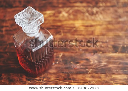Elegant carafe filled with whiskey, bourbon or rum Stock photo © dash