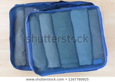 Packing clothes in a suitcase for travel Stock photo © vectorikart