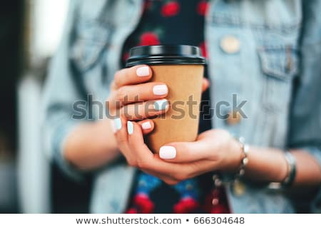woman drinking takeaway coffee in paper cup Stock photo © dolgachov