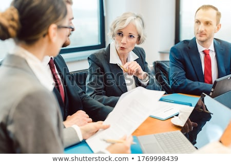 Experienced attorney with her team of professionals working Stock photo © Kzenon