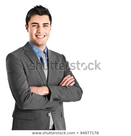 молодые · бизнесмен · оружия · сложенный · глядя · белый - Сток-фото © lithian