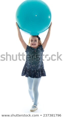 little at the beach holding inflatable ball above head stock photo © photography33
