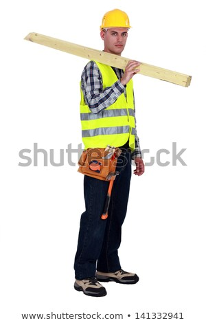 Stock photo: craftsman carrying two wooden boards on his shoulder