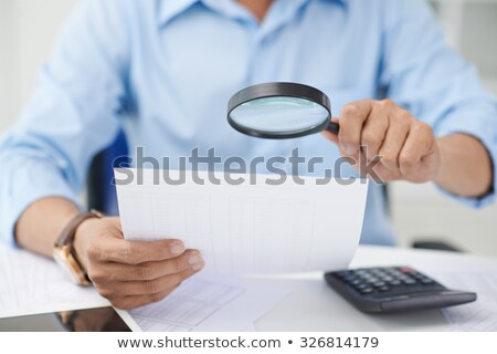 adviser with magnifying glass Stock photo © ssuaphoto