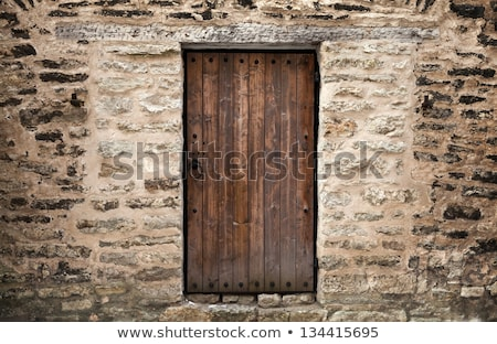 Stok fotoğraf: Wooden Door In A Stone Wall