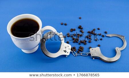 handcuff with coffee Stock photo © pterwort