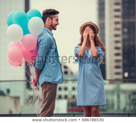 Férfi ajándék léggömbök valami fontos tart Stock fotó © kittasgraphics