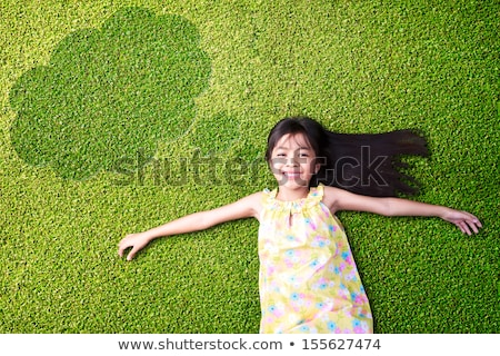 happy smiling girl resting on green grass outdoors portrait stock photo © victoria_andreas