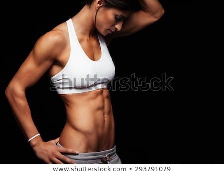 Beautiful and strong women's abs. Studio shot. Stock photo © Massonforstock