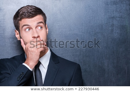 Stock photo: shocked business man covers mouth