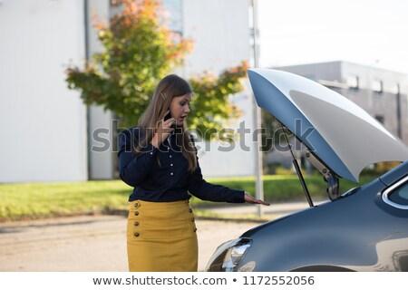 upset woman standing in front of a broken down car stock photo © stryjek