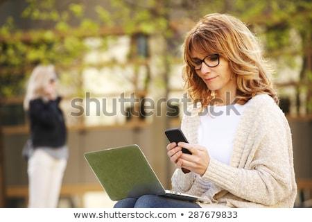 Felice donna matura iscritto sorridere bianco femminile Foto d'archivio © wavebreak_media