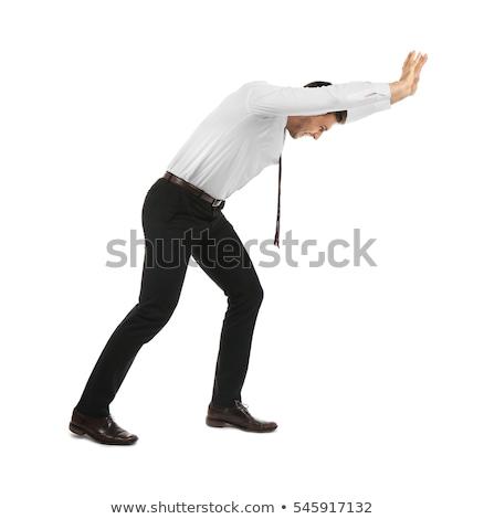business man pushing stock photo © fuzzbones0