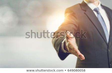 üzletember · zsákmány · valami · izolált · férfi · boldog - stock fotó © fuzzbones0