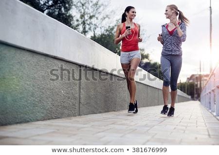 Fiatal nő fut kint város park hideg Stock fotó © lightpoet