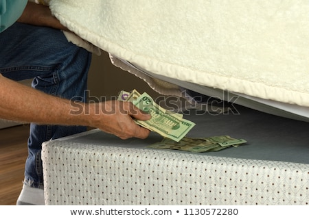 Hiding money Stock photo © Lightsource