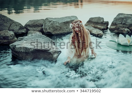 Woman at water. Creative photography Stock photo © artfotodima