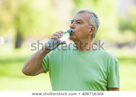 Thirsty man drinking water in the forest Stock photo © wavebreak_media