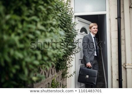 деловой человек ходьбе портфель кнопки костюм улыбаясь Сток-фото © feedough