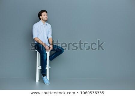 Sonriendo jóvenes casual hombre sesión taburete Foto stock © feedough