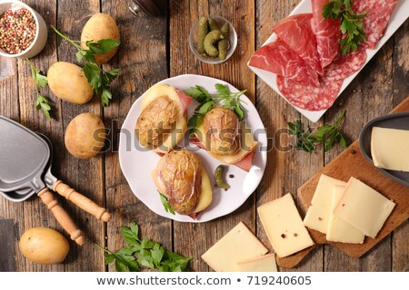 baked potato with ham and raclette cheese Stock photo © M-studio