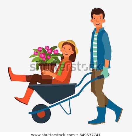 człowiek · popychanie · żona · taczki · drzewo - zdjęcia stock © is2
