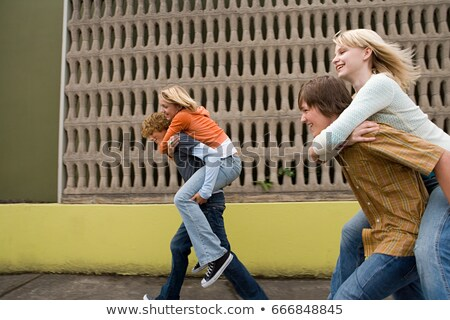 Four teenagers running piggy back races Stock photo © IS2