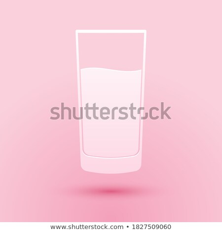 clean glass with water on a pink paper background with shadows stock photo © artjazz
