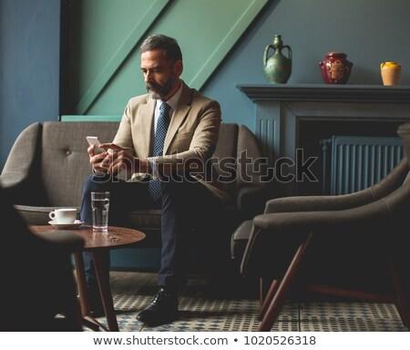 przystojny · starszy · biznesmen · pitnej · kawy · lobby - zdjęcia stock © boggy