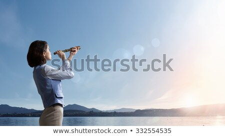 Businesswoman searchs for new horizon, new business opportunities Stock photo © alphaspirit