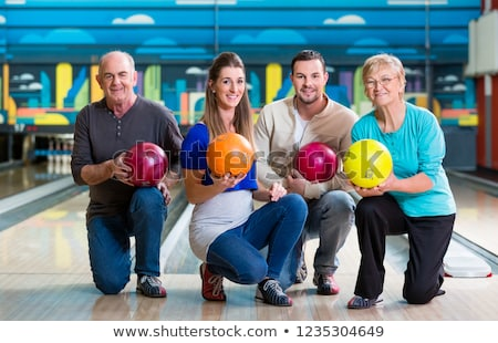 Family with multi colored bowling ball posing Stock photo © Kzenon