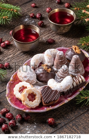 Christmas background with Linzer Christmas cookies and spruce branches Stock photo © madeleine_steinbach