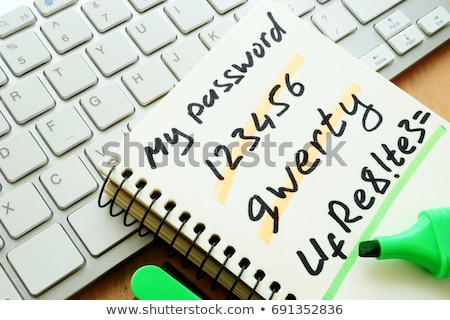 Login password on paper note and keyboard. Stock photo © vinnstock