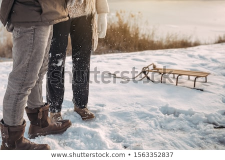 Winter boots on snow near sledge with rope. Stock photo © artfotodima