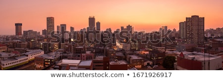 Сток-фото: Панорама · закат · город · силуэта · зданий · промышленных