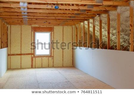 Bent szigetelés ház munkás plafon szoba Stock fotó © simazoran