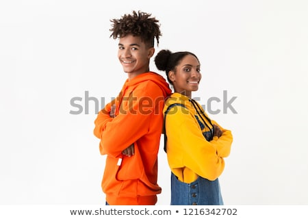 Photo of joyous african american couple in colorful clothes hold Stock photo © deandrobot