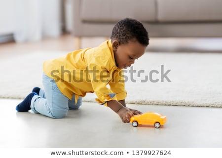 Baba fiú játszik játék autó otthon Stock fotó © dolgachov