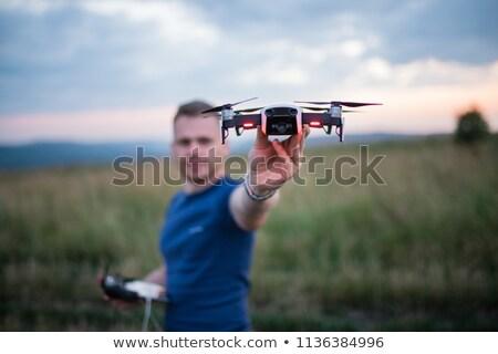Manos hombre panel de control cielo mano teléfono Foto stock © galitskaya