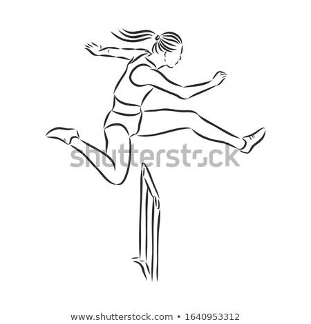 Girl running over hurdle Stock photo © bluering
