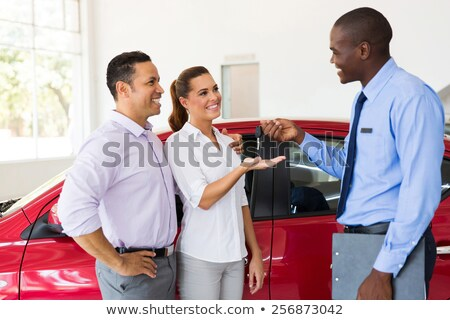 Dealer Handing Over Keys For New Car To Young Couple Stock photo © HighwayStarz