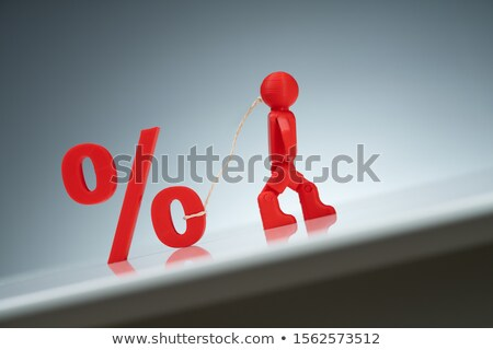 Human Figure Pulling Up A Percentage Symbol On Background Stock photo © AndreyPopov